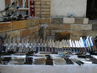 423886713 Samarkand, Uzbekistan, knives at covered central market